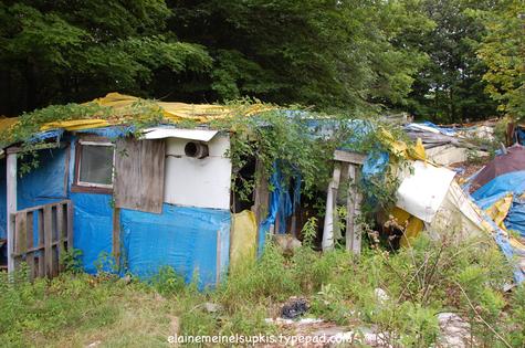 Tent_complex_front_door_covered_wit