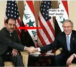 Maliki_looks_daggers_at_bush_1