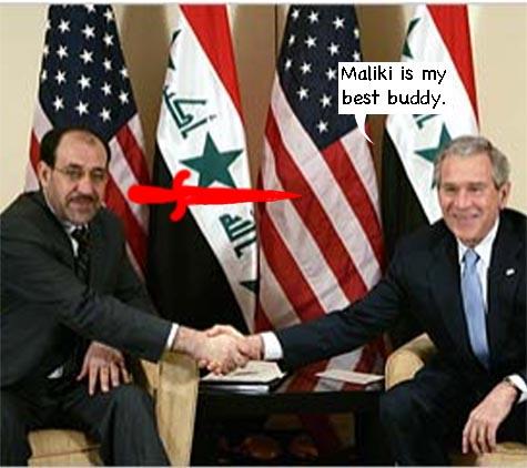 Maliki_looks_daggers_at_bush